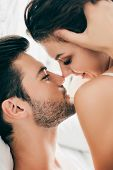 Close-up View Of Sensual Young Couple Able To Kiss In Foreplay poster