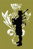stock photo of scottish thistle  - Silhouette of a bagpiper wearing a scottish kilt - JPG