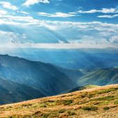 Mountains Landscape With Blue Hills And Sunrays poster