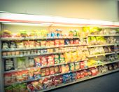 Blurry Background Snacks And Canned Chips At Pharmacy Store In America poster