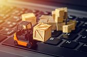 Forklift Freight Car Truck Loading Goods Product Wooden Boxes And Parcel On Laptop Computer Keyboard poster