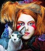 yong princess with cat. creative fantasy make-up.