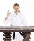 stock photo of martial arts girl  - Martial arts girl breaking a chocolate bar - JPG