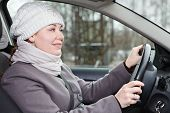 Woman In Winter Clothes Driving A Car Inside View