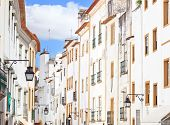 White Facades Old Urban Street In Evora. Alentejo, Portugal