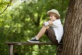 Boy Sits On A Bench