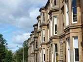 stock photo of edwardian  - A row of terraced houses in Glasgow West End Scotland - JPG