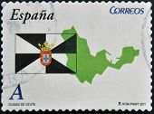 A stamp printed in spain shows flag and map of the autonomous city of Ceuta