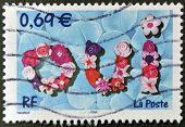A stamp printed in France shows the word yes in French: oui referring to the wedding