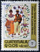 A stamp printed in Guatemala shows typical costumes of Guatemala circa 1970