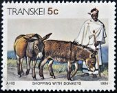 REPUBLIC OF SOUTH AFRICA - CIRCA 1984: A stamp printed in Transkei shows shopping with donkeys