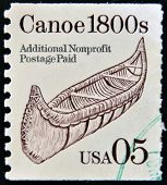 A stamp printed in USA shows canoe 1800s