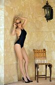 stock photo of one piece swimsuit  - Blond woman in black one - JPG