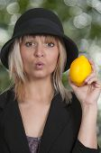 Woman Holding Lemon