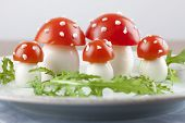 stock photo of agar  - Fly agaric mushrooms made from tomatoes and chicken and quail eggs - JPG