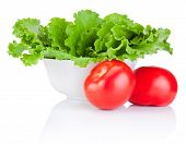 Bowl With Fresh Lettuce And Two Red Tomatoes Isolated On White Background