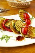 pic of brinjal  - Grilled vegetables and potato fritters on white plate - JPG