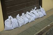 stock photo of sandbag  - sandbags to protect against flooding of the River during the flood - JPG