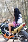 girl sitting on a motorcycle