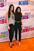 LOS ANGELES - MAY 11:  Kendall Jenner, Kylie Jenner attend the 2013 Wango Tango concert produced by