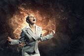 businesswoman in anger screaming against smoky background