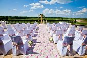 stock photo of wedding arch  - wedding ceremony set up in golf field - JPG