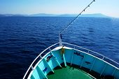 Bow of the boat on the blue sea with horizon in foreground