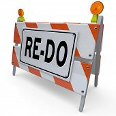A construction barricade sign with word Re-Do to illustrate a need to revise, change or improve to adapt to changing conditions or requirements