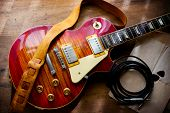 foto of solids  - Red sunburst solid body electric guitar - JPG