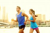stock photo of bridge  - City running couple jogging outside - JPG