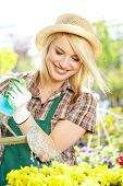 young blond girl with gardening tools
