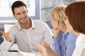 stock photo of work crew  - Businessman at meeting - JPG