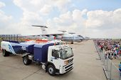 ZHUKOVSKY - AUGUST 12: Machine for refueling, aircraft, and crowd of spectators on airshow devoted t
