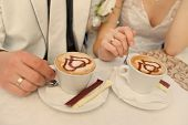 Man and woman with coffee cups on the table