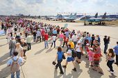 ZHUKOVSKY - AUGUST 12: Spectators and journalists on airshow devoted to 100 anniversary of Russian A