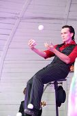 MOSCOW - AUGUST 10: Artist juggling balls on stage at festival of street theater and carnival cultur