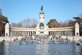 MADRID - MARCH 11: Tourists boat near monument to Alfonso XII at pond in Retiro Park on March 11 201