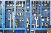 picture of deportation  - Special tools for car repairs are beyond blue lattice in closet - JPG