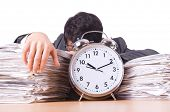 stock photo of frustrated  - Woman businessman with giant alarm clock - JPG
