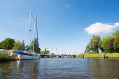 Dutch river the Eem with bridge and sailboat