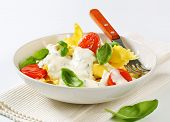 pasta salad with dressing and tomatoes