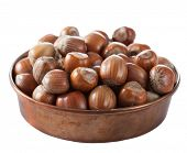 hazelnuts in copper bowl isolated