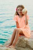 Summer beach, beach resort, summer joy - lovely girl with shell at the beach