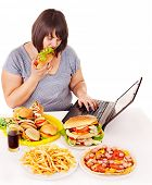 image of high calorie foods  - Woman eating fast food at social network - JPG