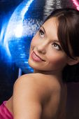 beautiful woman in evening dress with disco ball