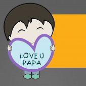 Cute little boy holding a heart shape note with text  Love You Papa on occasion of Fathers Day.