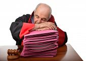 Senior adult judge exhausted from workload fell asleep