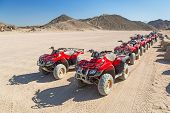 HURGHADA, EGYPT - APR 16: Quad trip on the desert near Hurghada on 16 April 2013. Desert safari is one of the main local tourist attraction in Egypt.