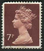 UK-CIRCA 1975:A stamp printed in UK shows image of Elizabeth II is the constitutional monarch of 16 sovereign states known as the Commonwealth realms, in Purple Brown , circa 1975.
