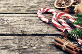 picture of candy cane border  - Vintage Christmas decorations with candy canes on wooden table